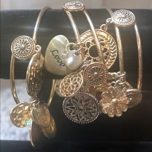 RJ Graziano set of six gold tone charm bracelets